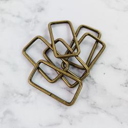 Pack 12 hebillas de metal 29*16 mm, bronce